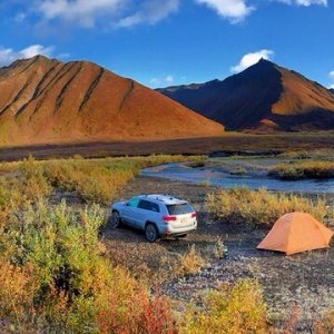 Camping and fly fishing in the Alaska Range at the edge of the roadless wilderness. Streams crossed, ruts navigated, and rocks climbed.