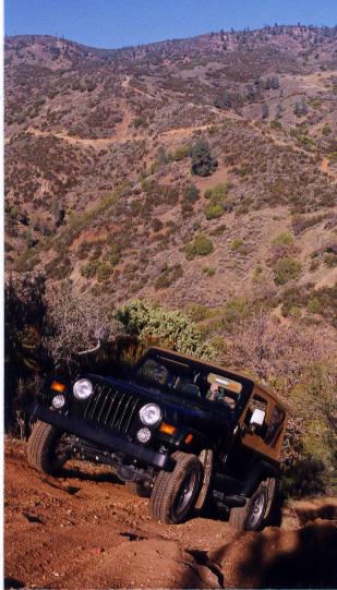 Wrangler climbing a hill